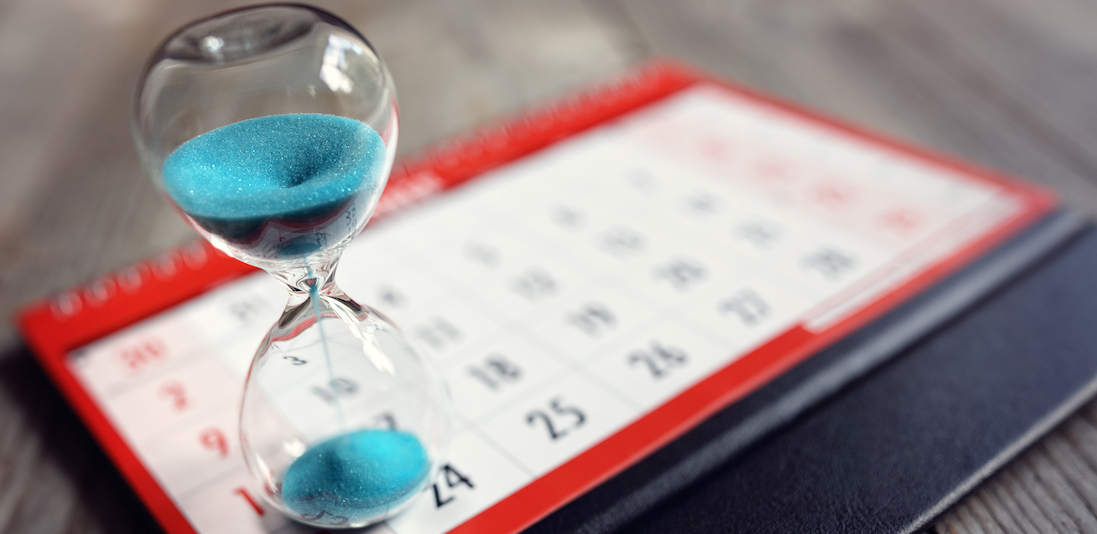 Hour glass on calendar
