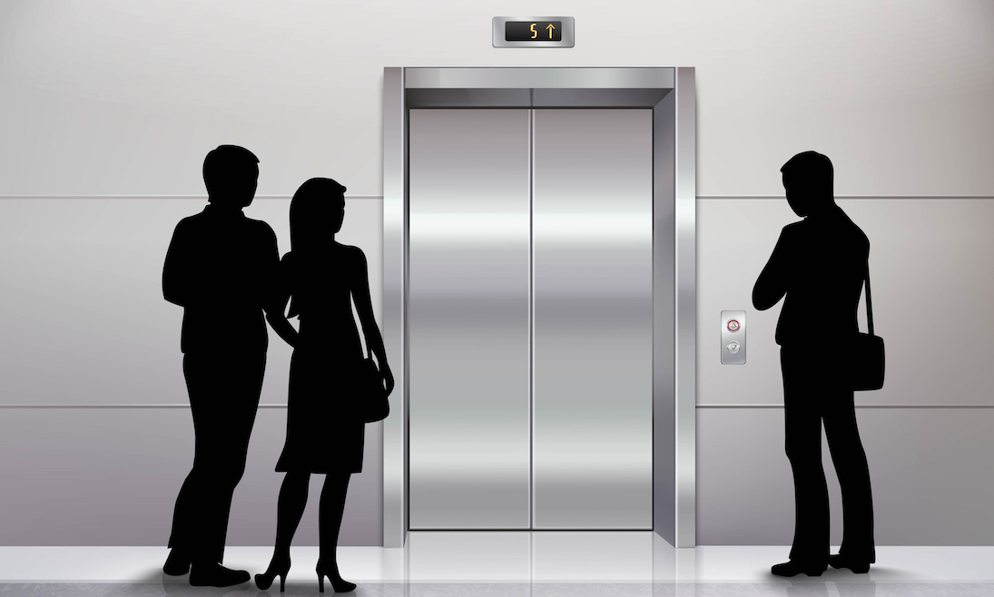 Three male and female people standing in front of modern elevator